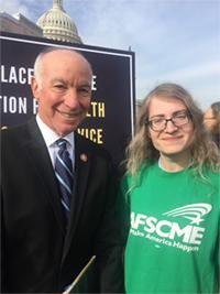 Connecticut Rep. Joe Courtney stands next to social worker Miriam Doyle.